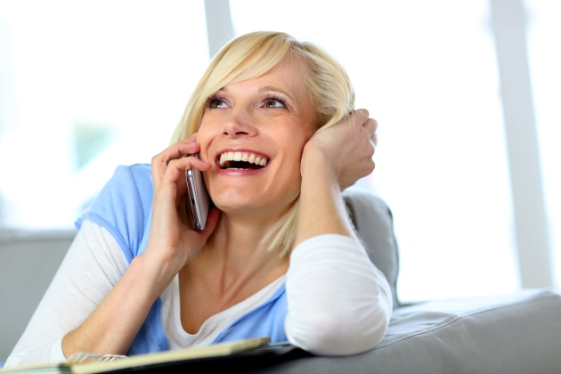 Beautiful blond woman laughing on the phone